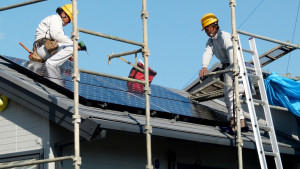 people working on a solar panel rooftop